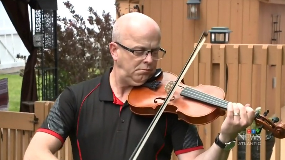Music teacher Shawn MacDonald, who taught Nova Scotia shooting victim Emily Tuck, plays a fiddle donated in her memory.