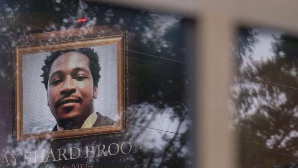 Photo of Rayshard Brooks is seen through a window