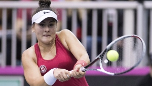 Bianca Andreescu of Canada returns to Lesia Tsurenko of Ukraine during their Fed Cup tennis match in Montreal on April 21, 2018. Andreescu has withdrawn from the Credit One Bank Invitational tennis tournament. THE CANADIAN PRESS/Graham Hughes