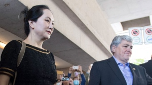 Meng Wanzhou, chief financial officer of Huawei, leaves B.C. Supreme Court in Vancouver, Wednesday, May 27, 2020 after the judge found that there is double criminality in the extradition of Wanzhou. THE CANADIAN PRESS/Jonathan Hayward