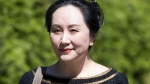 Meng Wanzhou, chief financial officer of Huawei, leaves her home to go to B.C. Supreme Court in Vancouver, Wednesday, May 27, 2020. THE CANADIAN PRESS/Jonathan Hayward