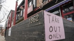 "A restaurant in Toronto displays a ""Take Out Only"" sign on Wednesday, March 18, 2020. Ontario's two most heavily populated regions will see more businesses open their doors today as Toronto and Peel move into the next stage of the province's COVID-19 recovery plan. THE CANADIAN PRESS/Frank Gunn"