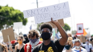 Black Lives Matter protests have not led to a spike in coronavirus cases, research says. (Marcio Jose Sanchez/AP)