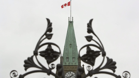 The Peace Tower on Parliament Hill is framed by the iron gates in Ottawa, Ont., on Wednesday, Sept. 16, 2009. (Sean Kilpatrick / THE CANADIAN PRESS)