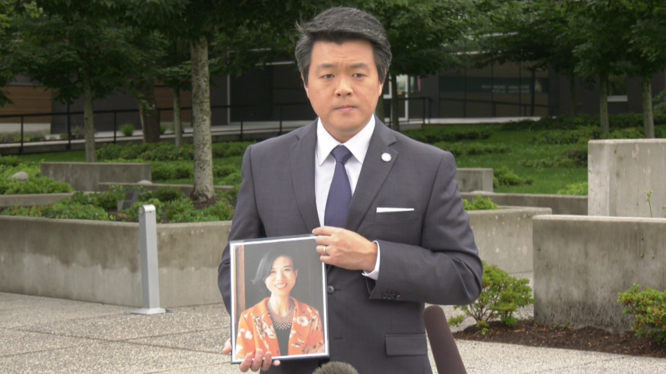 Sgt. Frank Jang holds a photo of Bo Fan, the victim of a homicide in Surrey, B.C.