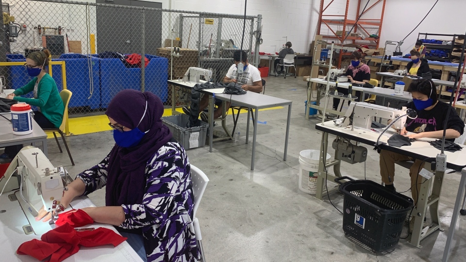 Workers inside facility sewing face masks