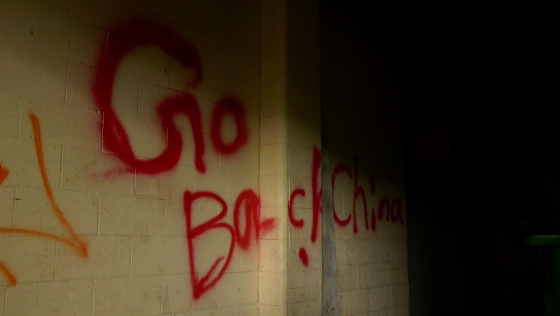 Emergency crews encountered the words 'Go back to China' spray-painted on a wall of the Chinese Village Restaurant in downtown Calgary during the June 23 response to a fire and break-in.