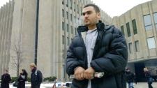 Abdurahman Khadr walks away from Ontario Superior Court following his brother's bail hearing in Toronto Wednesday, Dec. 21, 2005. (CP PHOTO/Aaron Harris)