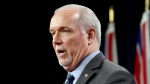 Premier John Horgan speaks during a press conference at B.C. Legislature in Victoria, B.C., on Wednesday, February 12, 2020. THE CANADIAN PRESS/Chad Hipolito