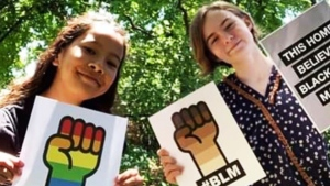 Sofi Ishikura, left, and Callie Leszek are seen with their posters in this photo. (Supplied)