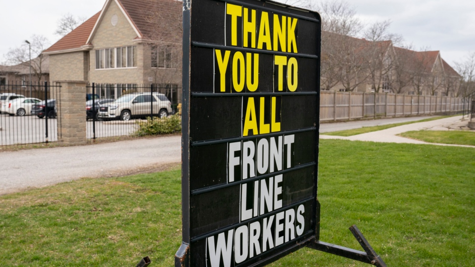 A sign showing support for workers sits on the property beside Anson Place care centre in Hagersville, Ontario on Wednesday, April 22, 2020. THE CANADIAN PRESS/Frank Gunn