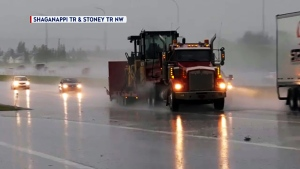 A severe thunderstorm watch was issued for Calgary late Monday afternoon, warning of heavy rains, wind and hail much like this supper-hour thunderstorm that  struck parts of Calgary in mid-July.