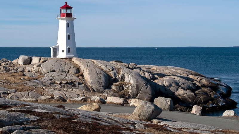 The lighthouse at Peggy's Cove, N.S., one of the favourite year-round destinations for visitors in Atlantic Canada, is seen on Monday, March 23, 2020. THE CANADIAN PRESS/Andrew Vaughan