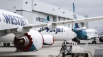WestJet Boeing 737 Max aircraft are shown at the airline's facilities in Calgary, Alta., Tuesday, May 7, 2019. WestJet Airlines Ltd. says it has halted its push for a labour code exemption that would have facilitated mass layoffs.THE CANADIAN PRESS/Jeff McIntosh
