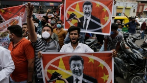 Karni Sena supporters hold banners featuring Chinese President Xi Jinping and shout slogans during a protest against China in Ahmedabad, India, Wednesday, June 24, 2020. (AP Photo/Ajit Solanki)