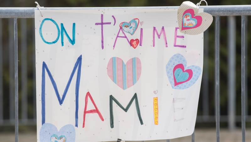 A sign with a message translating to 'We Love You Mom' is shown outside a long-term care home in Montreal, Saturday, April 18, 2020. THE CANADIAN PRESS/Graham Hughes