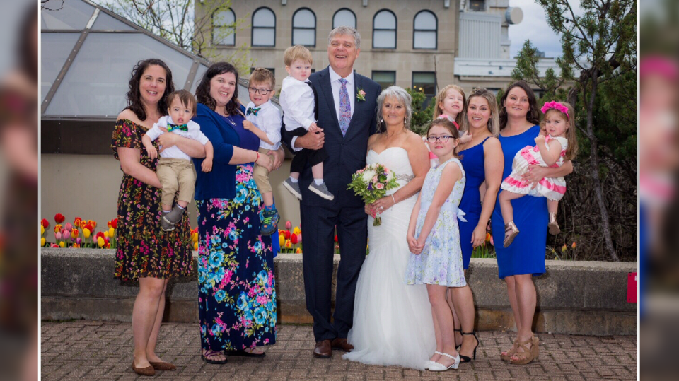 Ottawa Hospital volunteer Mike Soloski with his wife and family on their wedding day.