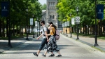 People walk past the University of Toronto campus during the COVID-19 pandemic in Toronto on Wednesday, June 10, 2020. The Ontario government announces the framework for reopening of colleges and universities as early as of July. THE CANADIAN PRESS/Nathan Denette