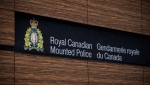 "The RCMP logo is seen outside Royal Canadian Mounted Police ""E"" Division Headquarters, in Surrey, B.C., on April 13, 2018.THE CANADIAN PRESS/Darryl Dyck"