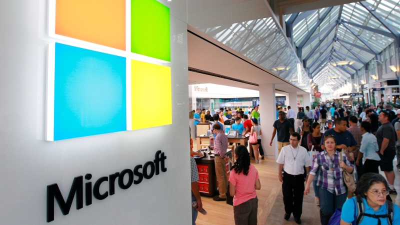 In this Thursday, Aug. 23, 2012, file photo, a new Microsoft Corp. logo, left, is seen on an exterior wall of a new Microsoft store inside the Prudential Center mall, in Boston. (AP / Steven Senne)
