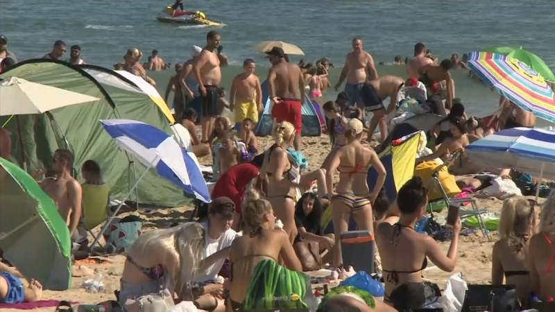 Nevermind physical distancing, thousands of people flocked to beaches in southern England to enjoy themselves on the hottest day of the year so far.