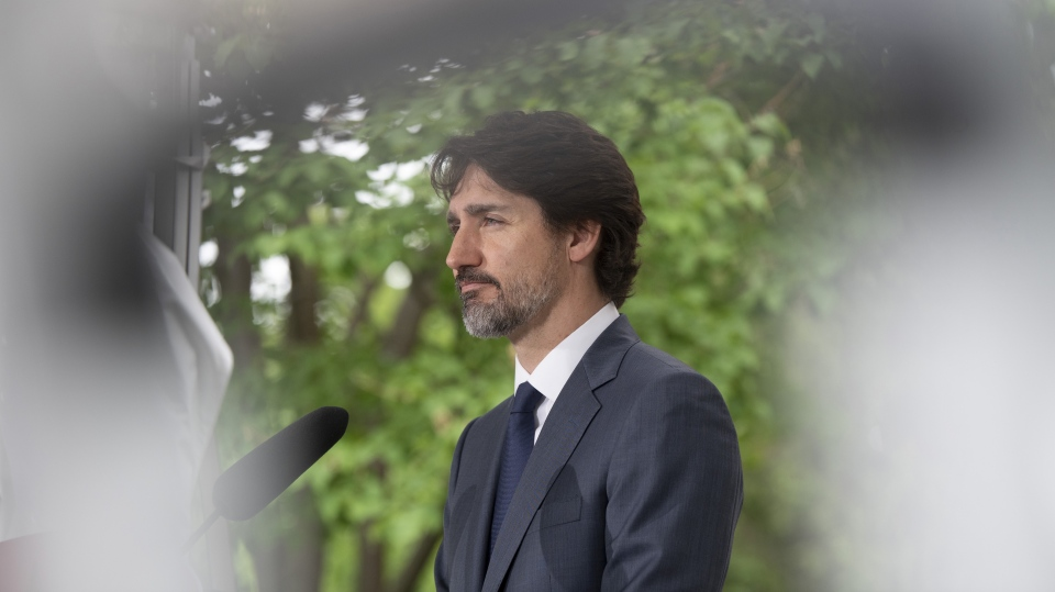 Prime Minister Justin Trudeau responds to a question during a news conference outside Rideau Cottage in Ottawa, Thursday, June 25, 2020. Trudeau says Canadian companies are now producing so much personal protective equipment needed in the fight against COVID-19 that Canada is almost at the point of being self-sufficient. THE CANADIAN PRESS/Adrian Wyld
