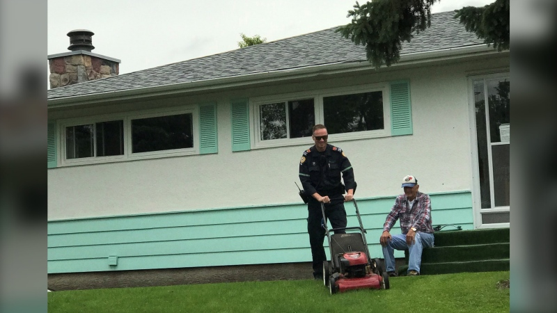 Alberta Health Services paramedic Josh mowed the lawn for a Calgary senior after confirming the man was not in medical distress following an automated call for help (image: AHS EMS)