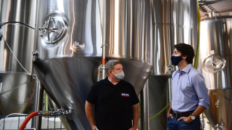 Prime Minister Justin Trudeau talks with Big Rig brewmaster Lon Ladell as he visits the brewery amid the COVID-19 pandemic in Ottawa on Friday, June 26, 2020. (Sean Kilpatrick/THE CANADIAN PRESS)