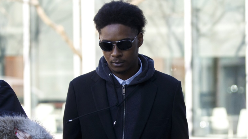 Dafonte Miller arrives for his testimony at the Durham Region Courthouse in Oshawa, Ont., Wednesday, Nov. 6, 2019. A Toronto police officer and his brother who are accused of brutally beating a young Black man more than three years ago are expected to learn their fate today. THE CANADIAN PRESS/Cole Burston