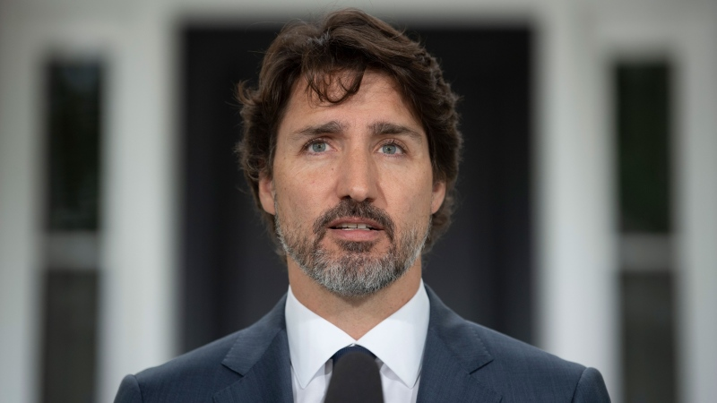 Prime Minister Justin Trudeau looks at the camera as he responds to a question about China during a news conference outside Rideau Cottage in Ottawa, Thursday, June 25, 2020. THE CANADIAN PRESS/Adrian Wyld