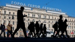 """In this Friday, May 1, 2020 photo, a sign reads """"Hero City Leningrad"""" installed atop the Oktyabrskaya Hotel across from the Moskovsky railway station in St.Petersburg, Russia. (AP Photo/Dmitri Lovetsky)"""
