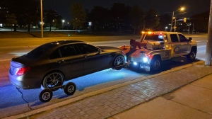 A vehicle is impounded by police after being caught speeding in a 50 km/hr zone. (Toronto Traffic Services/Twitter)