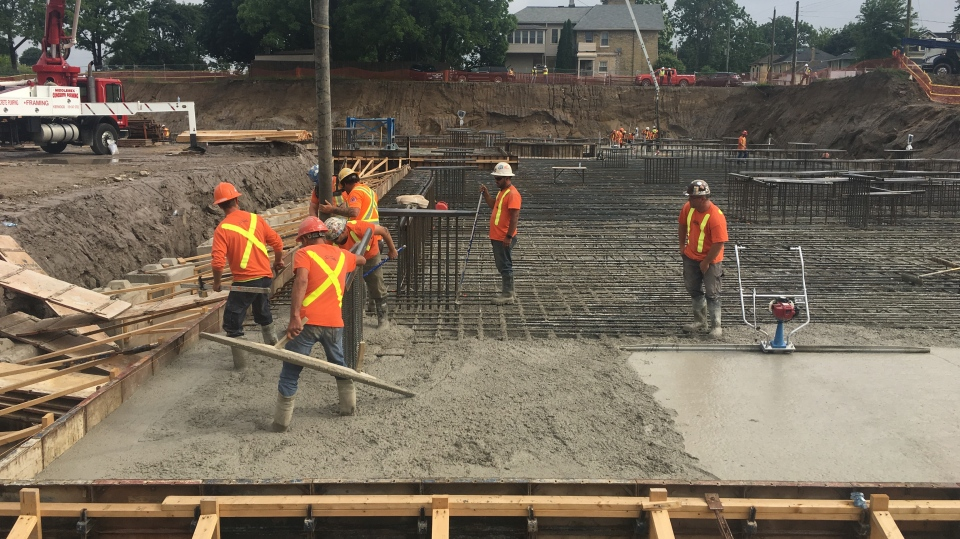 Concrete foundation being poured at the former Alma College site (Brent Lale / CTV News)