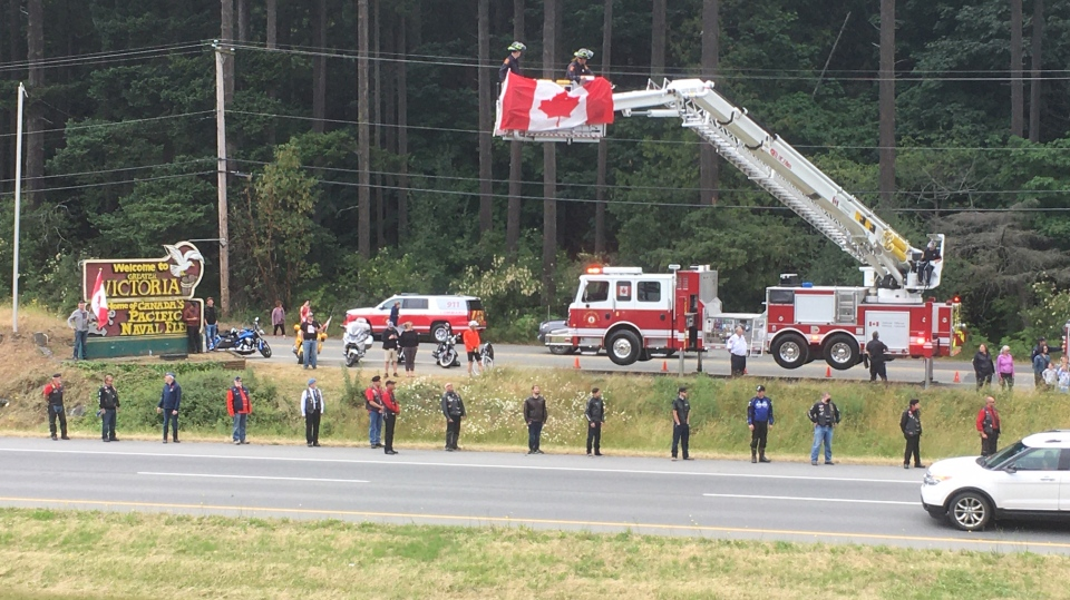 Mourners lined parts of the Pat Bay Highway to pay their respects to the fallen officer. Among the crowd were fire crews from Candian Forces Base Esquimalt, who displayed a Canadian flag from one of their ladder trucks in Hagen's honour. (CTV)
