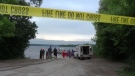 Emergency responders at the edge of Rice Lake near Peterborough, Ont. after a boat crash, Sat. June 27, 2020 (Harrison Perkins/CTV News)
