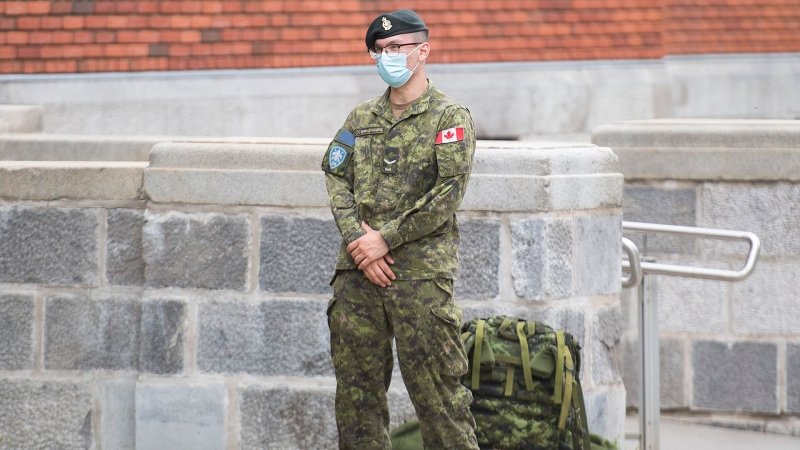 A member of the Canadian Armed Forces is shown on a street in Montreal, Saturday, June 27, 2020, as the COVID-19 pandemic continues in Canada and around the world. THE CANADIAN PRESS/Graham Hughes