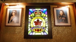 Photos of royalty hang on the walls at The Royal Canadian Legion, St James Branch No. 4 in Winnipeg, Manitoba Thursday, November 8, 2018. Legions across Canada are facing funding challenges and volunteer shortages because of aging member demographics. THE CANADIAN PRESS/John Woods