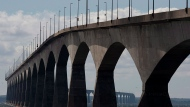 """The Confederation Bridge is viewed from Borden-Carleton, P.E.I. on Friday, Sept. 27, 2013. Canada's smallest province, which once branded itself the """"gentle island,"""" is seeing some not-so-gentle attitudes emerging toward people perceived to be from other provinces, a phenomenon Prince Edward Island Premier Dennis King says is likely driven by COVID-19 fears. (THE CANADIAN PRESS/Andrew Vaughan)"""