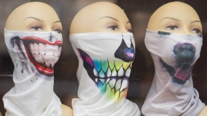 Face coverings are shown in the window of a store in Montreal, Saturday, June 27, 2020, as the COVID-19 pandemic continues in Canada and around the world. THE CANADIAN PRESS/Graham Hughes