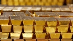 FILE - In this Tuesday, July 22, 2014, file photo, gold bars are stacked in a vault at the United States Mint, in West Point, N.Y. THE CANADIAN PRESS/AP-Mike Groll