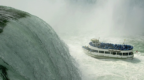 The Maid of the Mist navigates the turbulent waters of the lower Niagara river at the base of Horseshoe Falls, as seen from Niagara Falls State Park in Niagara Falls, N.Y. on Friday, Sept. 28, 2007. (AP Photo/Don Heupel)
