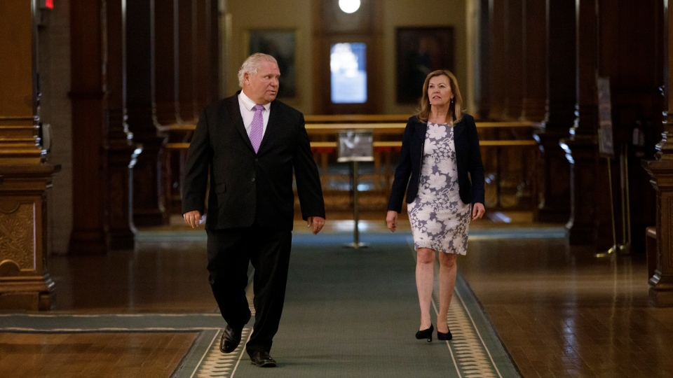 Ontario Premier Doug Ford, left, and the Minister of Health Christine Elliott walk to their daily press briefing at Queen's Park in Toronto on Friday, June 26, 2020. THE CANADIAN PRESS/Cole Burston