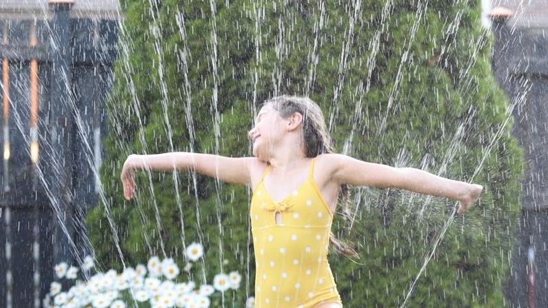 Kid in sprinkler