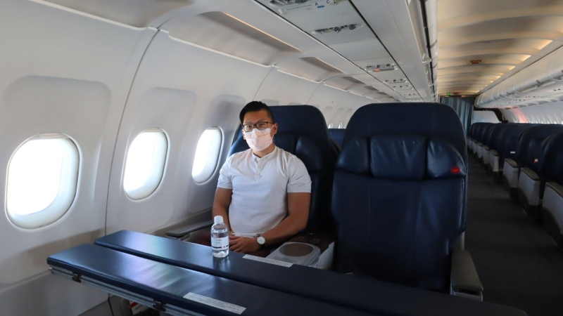 Ricky Zhang, pictured on a Jetz flight, Air Canada's celebrity and athlete charter service, on June 1. He told CTVNews.ca that flying during the COVID-19 pandemic was 'eerie.' (Prince of Travel)