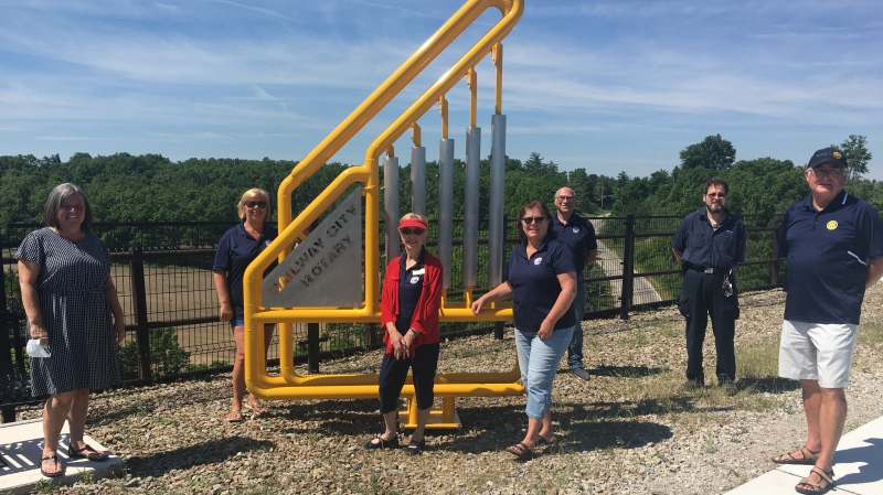 Members of Railway City Rotary Club with the new musical instruments at the Elevated Park in St. Thomas, Ont. on Monday, June 29, 2020. (Brent Lale / CTV News)