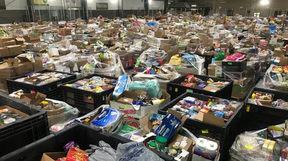 Food and hygiene supplies collected from the June 27th Miracle fill an arena at the WFCU Centre in Windsor, Ont. on Monday, June 29 2020. (Rich Garton/CTV Windsor)