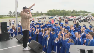 The appearance of a surprise musical guest – rapper, Classified –quickly turned the ceremony into a concert-like atmosphere, as graduates got up from their seats and gathered together in front of the stage. Attendees could also be seen exiting their vehicles and moving around the parking lot.