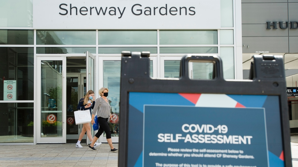 People leave Sherway Gardens shopping mall during the COVID-19 pandemic in Toronto on Wednesday, June 24, 2020. Toronto and the GTA entered stage two of opening. (Nathan Denette/The Canadian Press)
