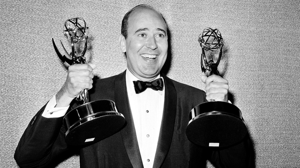 Carl Reiner holds two Emmy statuettes in 1963