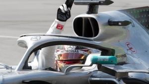 Mercedes driver Lewis Hamilton of Great Britain celebrates his victory at the Canadian Grand Prix, Sunday, June 9, 2019 in Montreal. THE CANADIAN PRESS/Jacques Boissinot